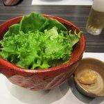 10349284 - 料理の最初はサラダ、ドレッシングではなくて添えられてる味噌をつけて食べる様になってます。