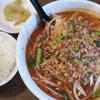 一球酒場 - 料理写真:汗辛刀削麺+サービスライス