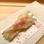 103749567 - 白魚に桜塩をかけて