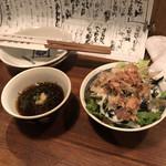103762815 - 定食の小鉢とサラダ