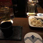 104257448 - お通しとウコン茶とコンソメスープ