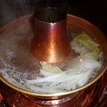 しゃぶ禅 -  しゃぶしゃぶの鍋の中で調理している野菜です。