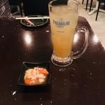 105306308 - お通し(人参と鶏肉の煮物)/グレープフルーツサワー