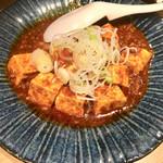 105677870 - ピリ辛マーボー豆腐(380円)上野で人気の山椒のピリリと効いた逸品。