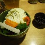 10584483 - 御通しの生野菜と特製の味噌