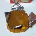 満願堂 - アルミシールは添付のプラスチックナイフで切って開封します