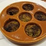 107143512 - エスカルゴのオーブン焼き アーモンドと香味野菜の香りで