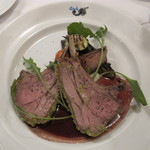 トラットリア デル チェーロ - 骨付き仔羊ロース肉の香味グラチネ