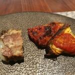 108531149 - 右はトマトソースやカリカリチーズが絶妙な茄子のオーブン焼き、左は旨味が凝縮した牛テールとレーズンのジェラティーナ