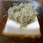 10855016 - 突き出しの1品です。 濃厚豆腐ですよ。 ビールのアテとしてはいい感じです。