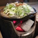 108809315 - どぜう鍋は、炭火で熱せられてます