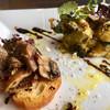 イタリア料理 レガメント - 料理写真:「ブルスケッタ      (マッシュルームのアンチョビソテー)」 「じゃがいもとそら豆の香草パン粉焼き」