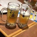 博多満月 - ビールはサッポロ ジョッキが可愛い