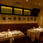イル バッティクオーレ - 落ち着いた雰囲気のテーブル席