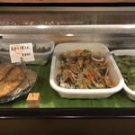 109245310 - お惣菜が並びます。