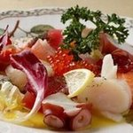 ブルーラグーン レストラン - 料理写真:毎日入荷する新鮮キトキトな魚介類☆一番人気はシーフードカルパッチョ