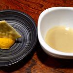 10958430 - 雷門き介 神保町店 突出しのかぼちゃサラダと貝のスープ