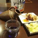 10965102 - 喰い差しの皿:レバ(たれ)とシロ(塩); 鳩燗が嬉しい @2009/08/20