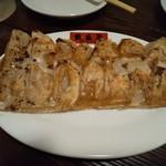 109721130 - 焼き餃子125円