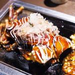 109885385 - 石川県産 丸ごと一匹使ったイカお好み焼き