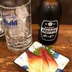 立飲み たきおか - 黒ホッピー+ホッキ貝