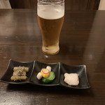 魚楽 - お通し ビール(プレモル)はクーポン利用で99円