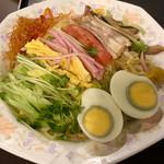 110664126 - 冷し中華に茹で卵をトッピング