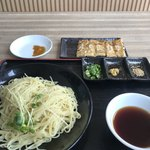110672051 - 情熱つけ麺(太麺)  299円と食べかけの金の延棒餃子6ケ  199円