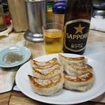 110956881 - 餃子とビール