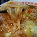 太陽のトマト麺 - トッピングのチーズが、麺と絡んでさらに濃厚に。