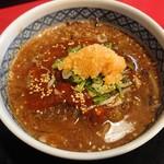 111364488 - 馬辛つけ麺のスープ                       辛さ控えめ×3、ニンニクあり、唐辛子