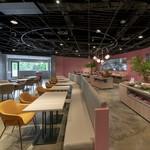 パークサイドキッチン - ピンクの壁やソファが可愛い内観です♪