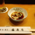 11163465 - 付き出しのなまこ酢(3口ほど食べてしまってから撮影)