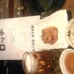 焼肉ロッヂ - 料理写真:最初に出される知床産地鶏・もやしのナムルと生ビール
