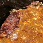 ばんちゃん酒房 - 熱い石鍋に接していた部分に麻婆豆腐のおコゲ