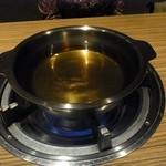 11449412 - ダシがはられたしゃぶしゃぶの鍋