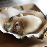 114660429 - ぷっくら焼き牡蠣