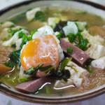 知花食堂 - 料理写真:具材はおばぁの気分しだい。自家製豆腐、ポーク、豚肉、キャベツ、わかめ、車麩、かまぶく、卵
