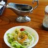 OKUBO - 料理写真:日替わりランチ用サラダ。グレイビーボート内はステーキソース、プラボトル内は中濃ソース。