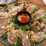 115468950 - 生ハムと半熟タマゴのシーザーサラダ