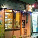 11559301 - 商店街の外れの小さなパン屋さんです。