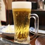 本格炭火焼き鳥&博多もつ鍋 串たつ - サッポロ黒ラベル生