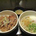 11643953 - 月替わりの定食・帯広名物・豚丼と釜玉うどん390円。