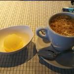 116939234 - デザートのシャーベットとコーヒーになります