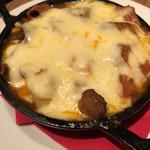 Bacco - モツ煮のチーズグラタンです。数種類のモツがふんだんに入っています。ケチャップソースが美味しいです。