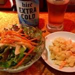 韓流居酒屋 ホランモン - 料理写真:お通し\1ooとマカロニサラダ\2oo