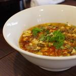 中国旬菜 茶馬燕 - 料理写真:酸菜豆花牛肉(土中発酵黄瓜と大根泡菜等の入った麻辣煮)