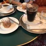 118647611 - モンブランとアイスコーヒー