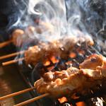 串焼 おんば - 料理写真:焼き鳥を焼いているところ
