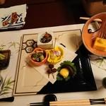 119109405 - 夕食 先付けの南瓜豆腐と前菜の皿 201911